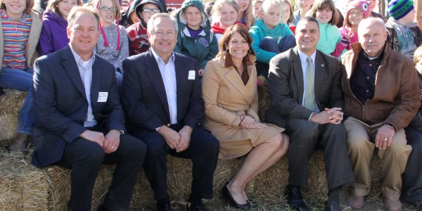Helping dedicate the Prairie Power Spoon River Solar Farm on Friday were nearly 100 students from Astoria. They joined (l-r) Prairie Power, Inc. Board Chairman Jim Thompson, Interim President/CEO Dan Breden, U.S. Rep. Cheri Bustos, State Rep. Michel Unes and Spoon River Electric Cooperative President/CEO Bill Dodds. The 500 kW solar farm includes a unique interactive learning center that is open to the students and the public. It is located 3 miles northeast of Summum, Ill. along Highway 24.
