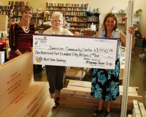 Jamieson Community Center Executive Director Nancy Mowen accepts an Operation Round-Up grant for the purchase of shelving for their Thrift Store. Pictured L-R: Kelly Hamm of McDonough Power, June Friend Operation Round-Up Trustee and Nancy Mowen.